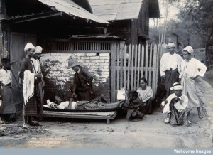 V0029676 An outdoor examination of a plague patient in Mandalay. Phot