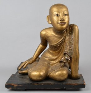 Museum No. As1983,05.7, 'Boy figure (kneeling, with base) made of wood, paint, glass, gilt'. © The Trustees of the British Museum